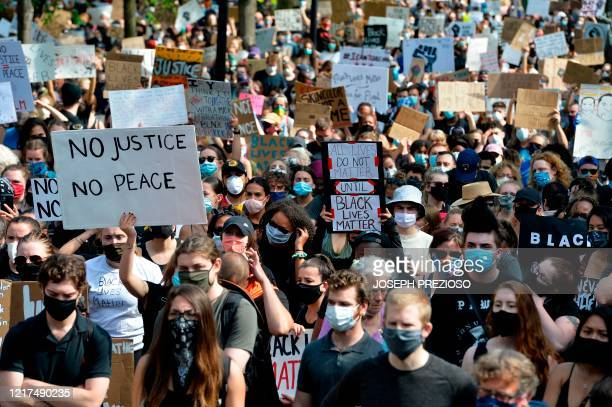 People march during a Black Lives Matter rally in response to the death of George Floyd and other victims of Police Racism across the US in Boston...