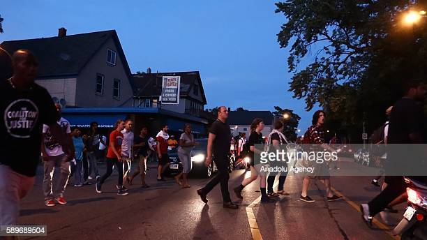 People march during a commemoration ceremony, held for Sylville Smith, who was shot and killed by a police officer as he reportedly attempted to flee...