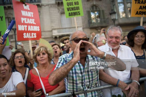People march during a demonstration against the last week's terrorist attacks on August 26 2017 in Barcelona Spain Hundreds of thousands people have...