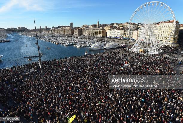 People march during a demonstration attended by an estimated 45000 on the old harbour in Marseille southern France on January 10 2015 as tens of...