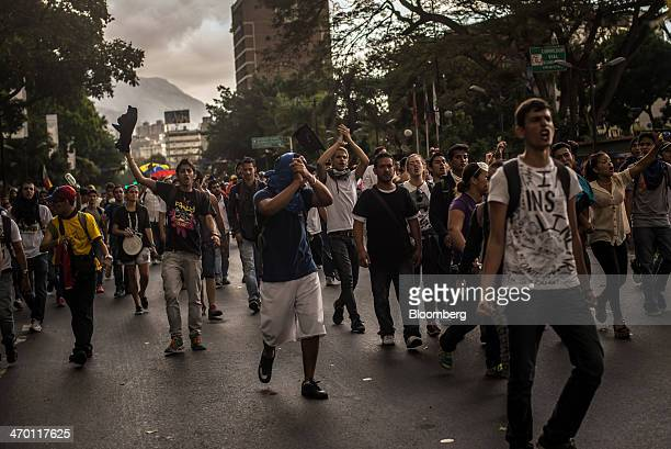 People march during a demonstration by a group made up of mostly students in Caracas Venezuela on Monday Feb 17 2014 Venezuela's government said it...