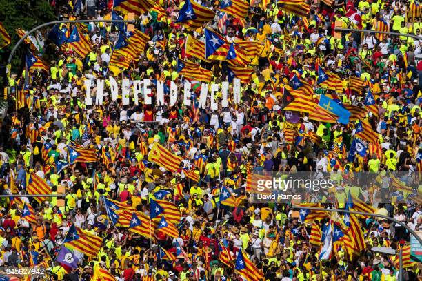 People march during a demonstration celebrating the Catalan National Day on September 11, 2017 in Barcelona, Spain. The Spanish Northeastern...