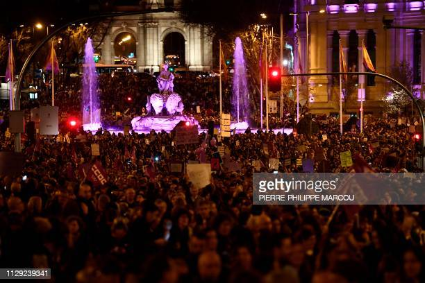People march during a demonstration marking International Women's Day at Cibeles square in Madrid on March 8 2019 Unions feminist associations and...