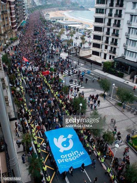 People march during a demonstration titled 'Human rights solution peace now the prisoners' to demand that ETA prisoners should to be held in jails...