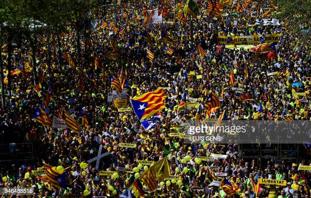TOPSHOT People march during a demonstration to support Catalan proindependence jailed leaders and politicians and called by 'Espai Democracia i...