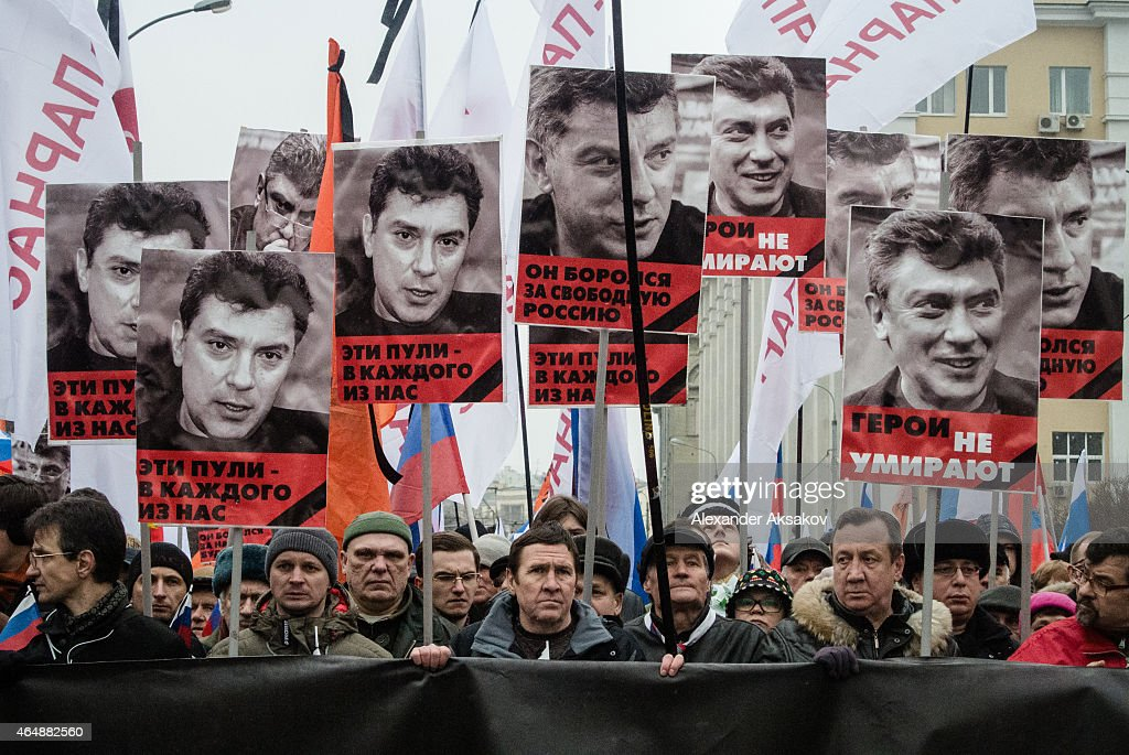 People march during a march in memory of Russian opposition leader and former Deputy Prime Minister Boris Nemtsov on March 01, 2015 in central Moscow, Russia. Nemtsov was murdered on Bolshoi Moskvoretsky bridge near St. Basil cathedral just few steps from the Kremlin on February 27. Nemtsov, a fierce critic of President Vladimir Putin, was shot dead ahead of a major opposition rally this weekend.