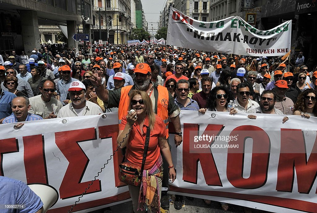 People march during a massive demonstration on May 5, 2010 in Athens.Three people were killed in a firebomb attack on a bank in central Athens on May 5 and around 20 people were evacuated from the building.
