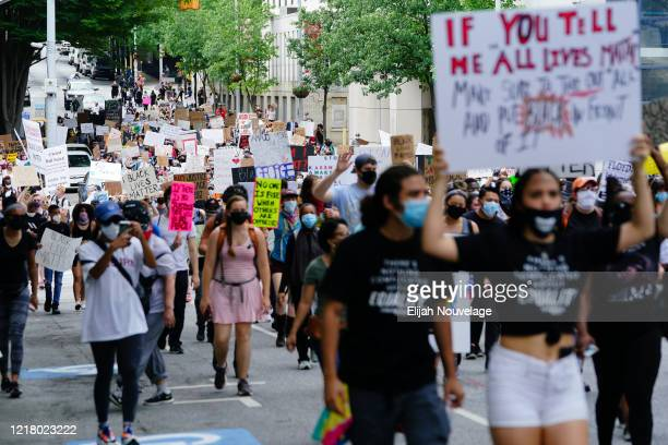 People march during a protest against police brutality on June 6 2020 in Atlanta Georgia This is the 12th day of protests since George Floyd died in...