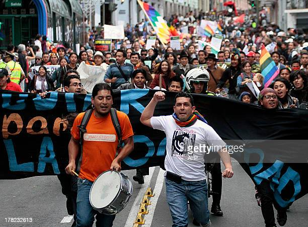People march during a protest against the exploitation of oil in the Yasuni National Park an incredibly biodiverse part of Ecuador's Amazon in Quito...