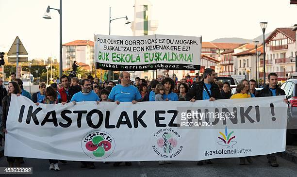 People march during a protest organized by the Seaska association of schools teaching in Basque language on November 8 2014 in Ciboure southwestern...