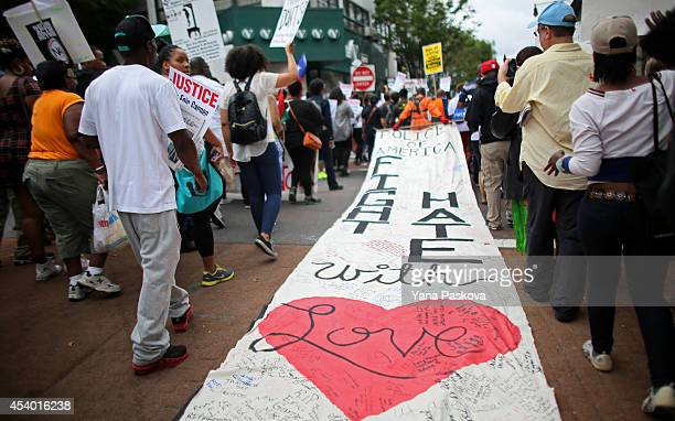 People march during a rally against police violence on August 23 2014 in the Staten Island borough of New York City Thousands of marchers are...