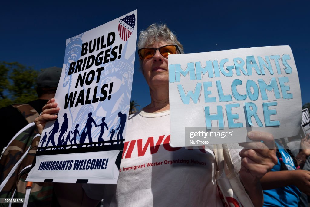 People march during a rally marking the international workers May Day in in Los Angeles, California on May 1, 2017. Activists marked the International Workers' Day with rallies in support of rights for workers and immigrants, as well as opposition to Presidents Donald Trump policies.