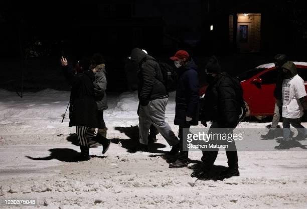 People march during a vigil for Dolal Idd, who was shot and killed by Minneapolis Police last night, on December 31, 2020 in Minneapolis, Minnesota....