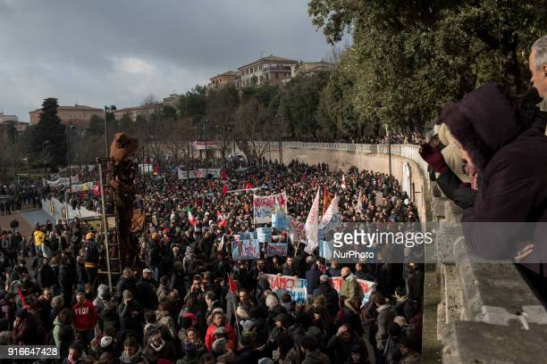 People march during an antiracism demonstration in the central Italian town of Macerata on February 10 one week after an attack that injured at least...