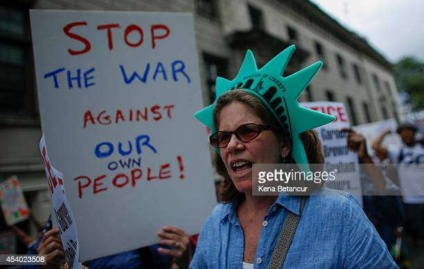 People march during rally against police violence on August 23 2014 in the borough of Staten Island in New York City Thousands of marchers are...