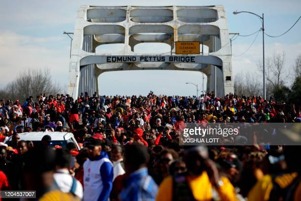 People march during the annual Bloody Sunday March across the Edmund Pettus Bridge in Selma, Alabama on March 1, 2020.