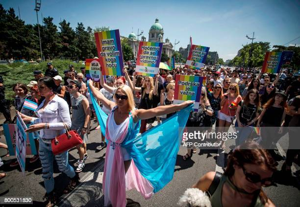 People march during the Gay Pride parade on June 24 2017 in Belgrade The march was held without incidents amid tight security as hundreds of riot...