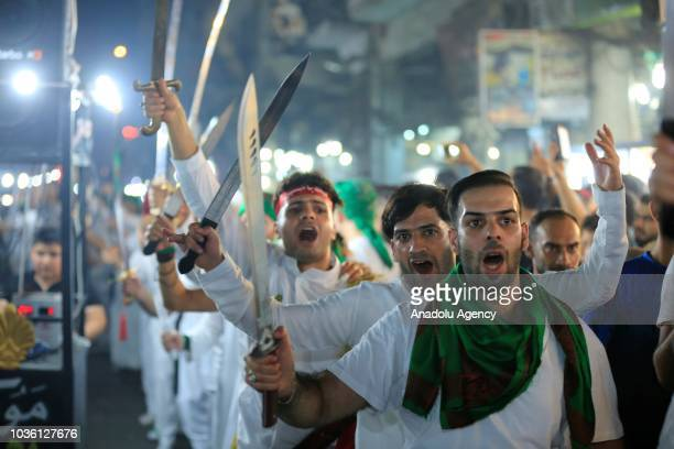 People march during the holy month of Muharram commemorations in Baghdad Iraq on September 19 2018 Ashure or Noah's Pudding dessert porridge made of...