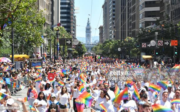 People march during the San Francisco gay pride parade in San Francisco California on June 2018