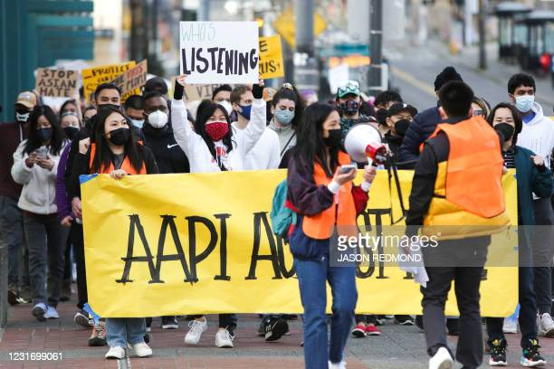 "People march during the ""We Are Not Silent"" rally against anti-Asian hate in response to recent anti-Asian crime in the Chinatown-International..."