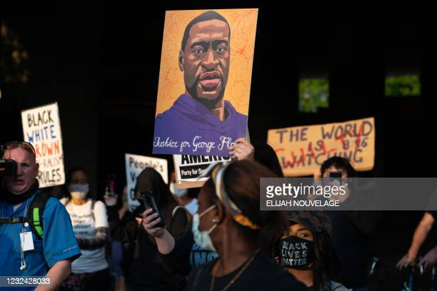 People march following the guilty verdict in the trial of Derek Chauvin on April 20 in Atlanta, Georgia. - Derek Chauvin, a white former Minneapolis...