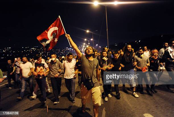 People march from Anatolian side to European side to Taksim square in Istanbul on June 16 2013 Police fired tear gas and jets of water to disperse...