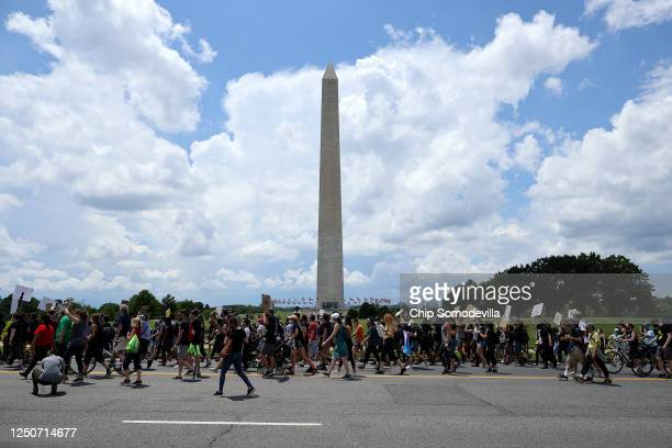 People march from the The National Museum of African American History and Culture to the Martin Luther King Jr Memorial to mark the Juneteenth...