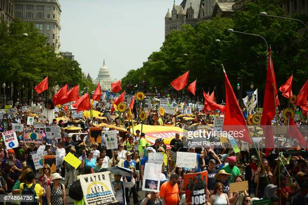 People march from the US Capitol to the White House for the People's Climate Movement to protest President Donald Trump's enviromental policies April...