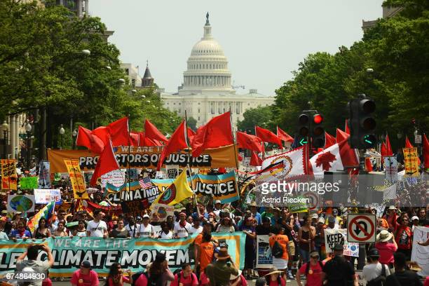 People march from the U.S. Capitol to the White House for the People's Climate Movement to protest President Donald Trump's enviromental policies...