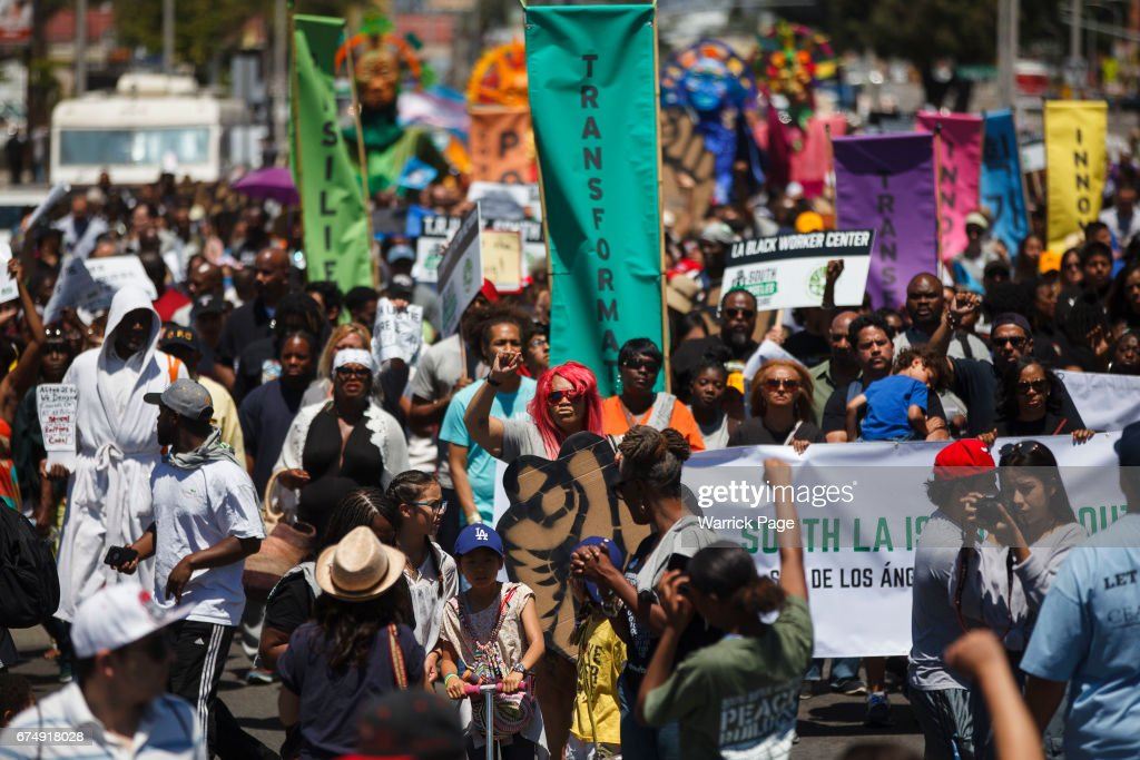 People march in a peace rally, marking the 25th anniversary of the LA riots, on April 29, 2017 in Los Angeles, California. Florence and Normandie was the flashpoint for the riots that was sparked by the police acquittals in the Rodney King beating.