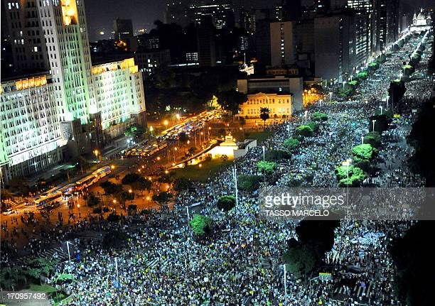 People march in downtown Rio de Janeiro on June 20 during a protest of what is now called the 'Tropical Spring' against corruption and price hikes...