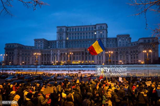 TOPSHOT People march in front of the Romanian parliament during a rally against the government's contentious corruption decree on February 4 in...