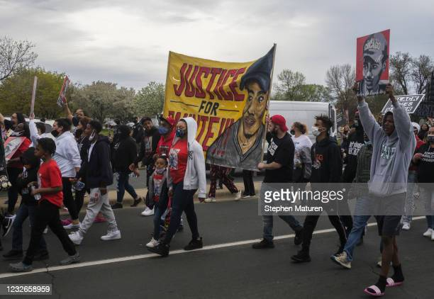People march in honor of Daunte Wright on May 2, 2021 in Brooklyn Center, Minnesota. Twenty-year-old Daunte Wright was shot and killed during a...