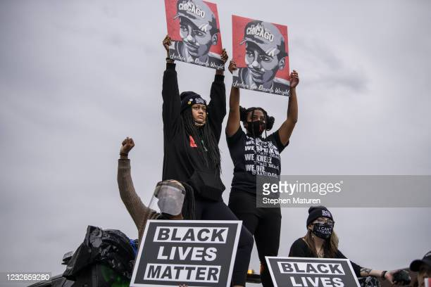 People march in honor of Daunte Wright outside the Brooklyn Center police headquarters on May 2, 2021 in Brooklyn Center, Minnesota. Twenty-year-old...