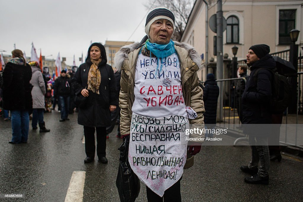 People march in memory of Russian opposition leader and former Deputy Prime Minister Boris Nemtsov on March 01, 2015 in central Moscow, Russia. Nemtsov was murdered on Bolshoi Moskvoretsky bridge near St. Basil cathedral just few steps from the Kremlin on February 27. Nemtsov, a fierce critic of President Vladimir Putin, was shot dead ahead of a major opposition rally this weekend.