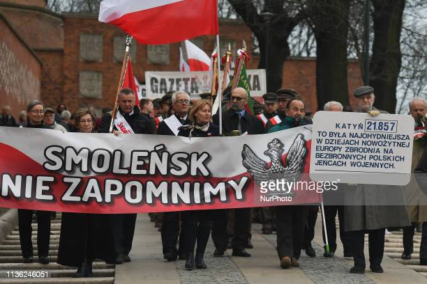 People march in procession from Wawel Castle to Katyn Cross monument after the Holy Mass for President Lech and Maria Kaczynski and all victims of...