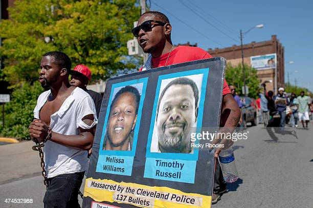 People march in protest to the Cuddell Recreation Center where Tamir Rice was killed in reaction to Cleveland police officer Michael Brelo being...
