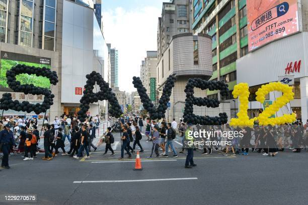 People march in support of Save12, the campaign to save twelve Hong Kong pro-democracy activists who on August 23 were caught by mainland Chinese...