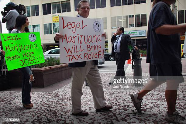 People march in support of the Florida Attorney General candidate Jim Lewis who is running on a platform of legalizing marijuana on October 12 2010...