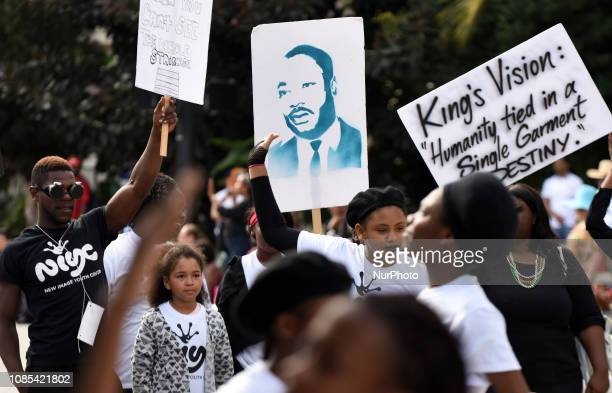 People march in the annual Dr Martin Luther King Jr Day Parade on January 19 2019 in Orlando Florida