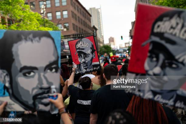 People march in the inaugural remembrance rally and march hosted by the George Floyd Global Memorial, commemorating the first anniversary of his...