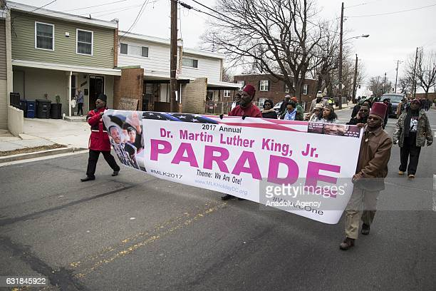 People march in the Martin Luther King Day Parade in memory of the Civil Rights leaders birthday in Washington USA on January 16 2017 The parade goes...