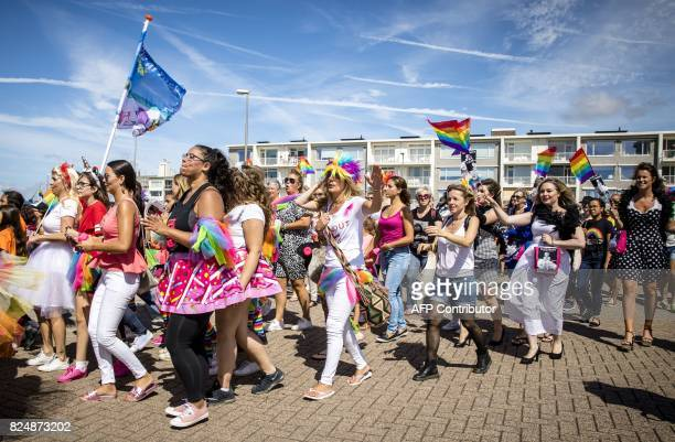 People march in the Pride at the Beach parade in the city centre of Zandvoort on July 31 2017 It is the first time the event which is part of Pride...