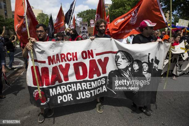People march in the street during a May Day and Immigration protest in Washington United States on May 1 2017