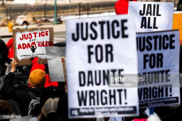 People march near the Colorado State Capitol to protest the deaths of Daunte Wright and Adam Toledo on April 17, 2021 in Denver, Colorado....