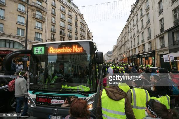 People march on January 5 2019 in Paris during a demonstration called by the yellow vests movement for the eighth week in a row of nationwide protest...