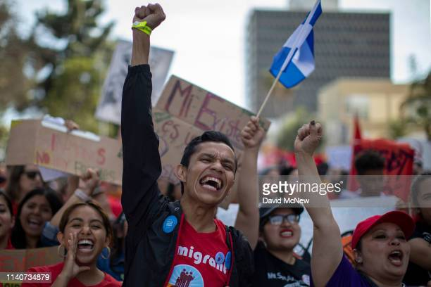 People march on May Day, also known as International Workers Day, on May 1, 2019 in Los Angeles, California. Thousands are participating in multiple...