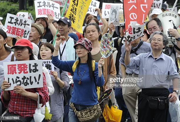 People march on the street during an anti nuclear demonstration in Tokyo on June 11 2011 Thousands of people staged antinuclear rallies and...