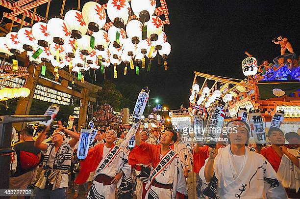 People march on with illuminated floats during the Mishima Summer Festival on August 16 2014 in Mishima Shizuoka Japan 500000 visitors are expected...