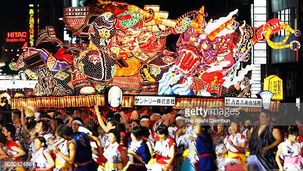 People march on with illuminated 'Nebuta' floats during the Aomori Nebuta Festival on August 2 2006 in Aomori Japan